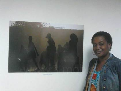 Photographer Annie Mphalume stands next to her entry