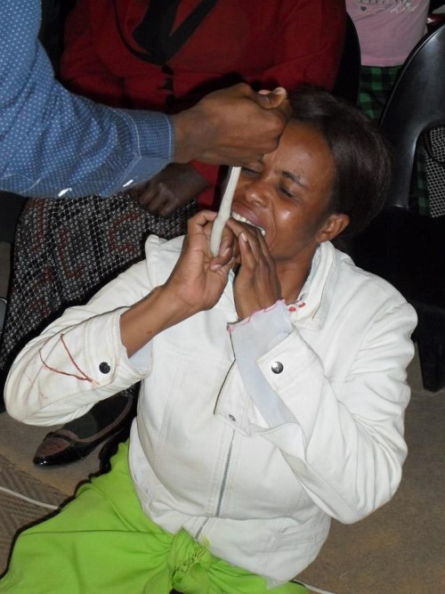 Woman eats snake after prophet says she should do so PIC: End Times Disciples Ministries Facebook page