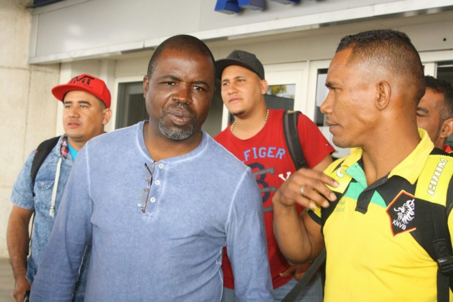 Jose Agustin Feria at Harare International Airport with Manyuchi's manager Chris Malunga