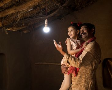 Rural Indian father with daughter delighted on electricity reaching their home