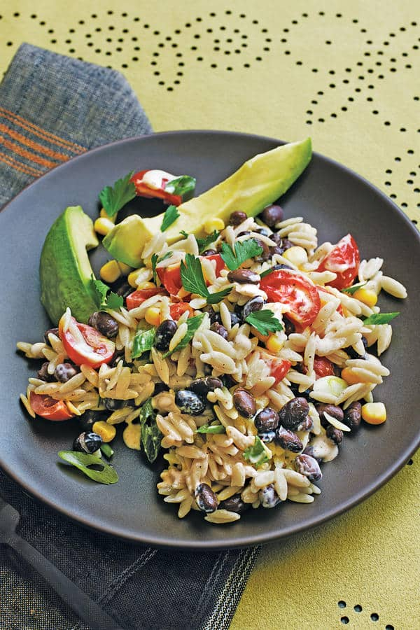 Orzo Pasta Salad with corn, cherry tomatoes, black beans, cilantro and lime.