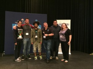 Michael Kintner with the winning team for the most innovative use of VR 360 video technology.