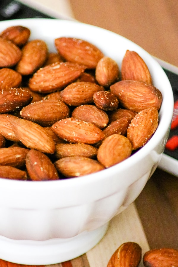 Close-up of a bowl of Baked Spiced Almonds.