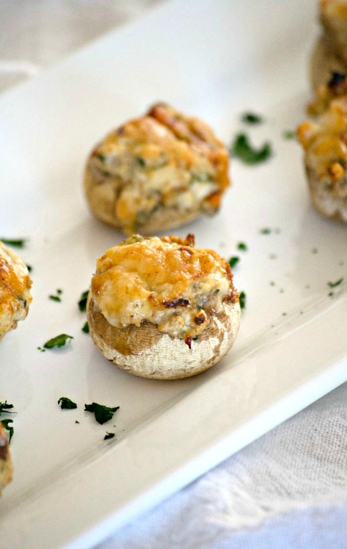 TheseCream Cheese Stuffed Mushroomsare button mushrooms filled with cream cheese and a simple season mixture. They're a simple and delicious appetizer that won't last long once they're set out!