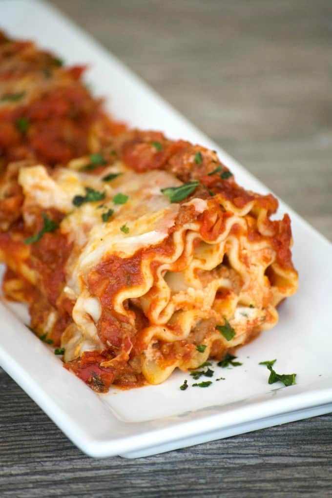 Cheese filled lasagna rolls topped with a flavorful meat sauce - a meal you can't help but share. Share them for your Glad to Give meal to see the smiles.