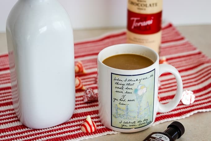 A cup of coffee with Peppermint White Chocolate Coffee Creamer.