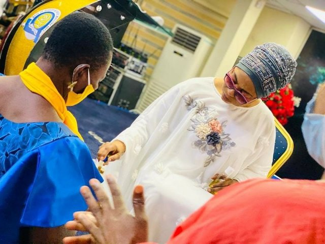 Billionaire businesswoman Folorunso Alakija pictured anointing her church members with olive oil 5