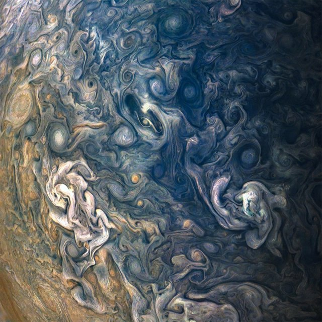 researchers-are-trying-to-make-sense-of-the-gas-giants-swirling-mess-of-polar-cloud-formations-like-these-captured-during-junos-tenth-perijove.jpg