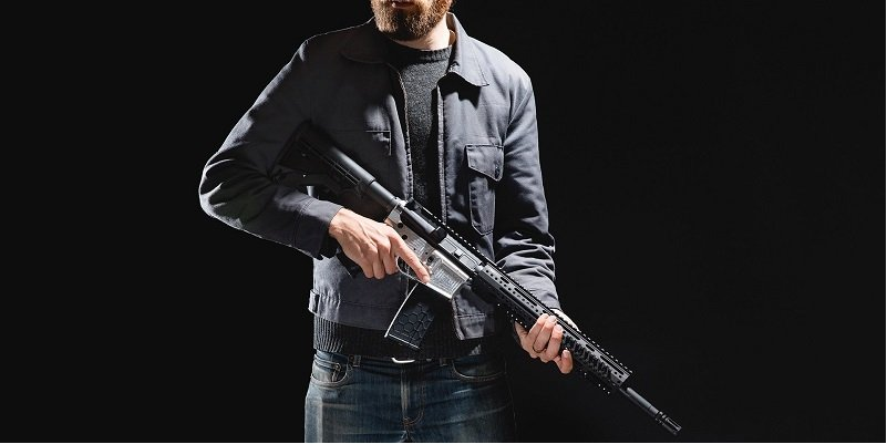 Andy Greenberg, poses with his CNC milled AR15 rifle.