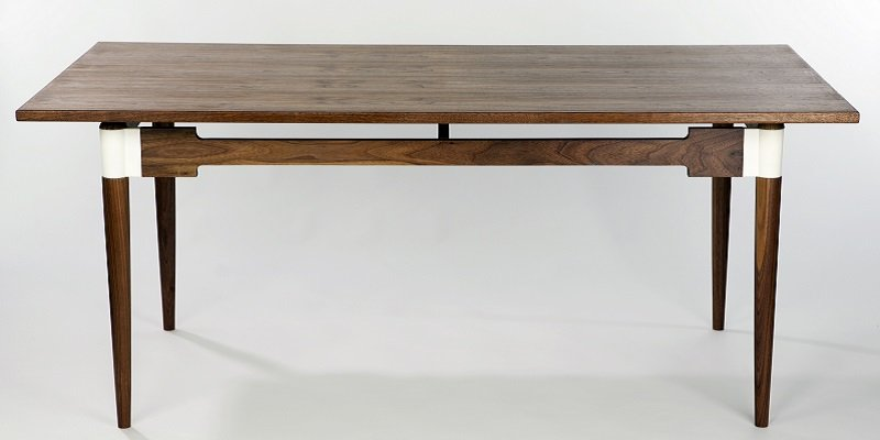 """The """"Saul"""" Dining room table, made from wood, with 3D printed joints."""