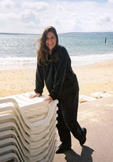 A photo Sheila took of Jae in labour leaning on plastic furniture on Bournemouth beach as a contraction has just passed