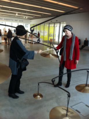 Gerda plays cymbals with sister Els