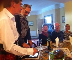 Ken-the-kilt and Stewart address the haggis