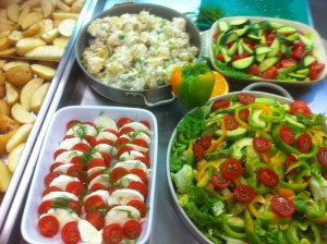 Salads made and potato wedges ready to go in the oven