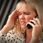 Blonde Woman on Her Cell Phone with Stressed Look on Her Face.