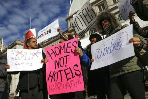 "Opponents of Airbnb rally before a hearing called ""Short Term Rentals: Stimulating the Economy or Destabilizing Neighborhoods?"" at City Hall in New York January 20, 2015.  REUTERS/Shannon Stapleton."