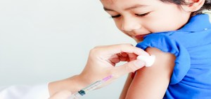 Boy and Vaccine Syringe