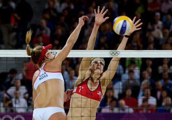 April Ross of USA spikes the ball past Kerry Walsh Jennings of USA during the Women's Beach Volleyball Final at Horse Guards Parade as part of the 2012 London Olympics - London, UK - 08 August 2012.