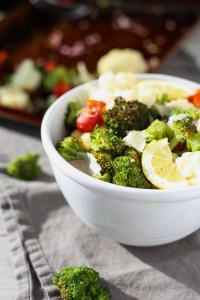 easy lemon roasted broccoli, cauliflower, and cherry tomatoes