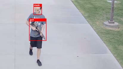 AI surveillance tracking systems identifying a gun and mask on an individual.