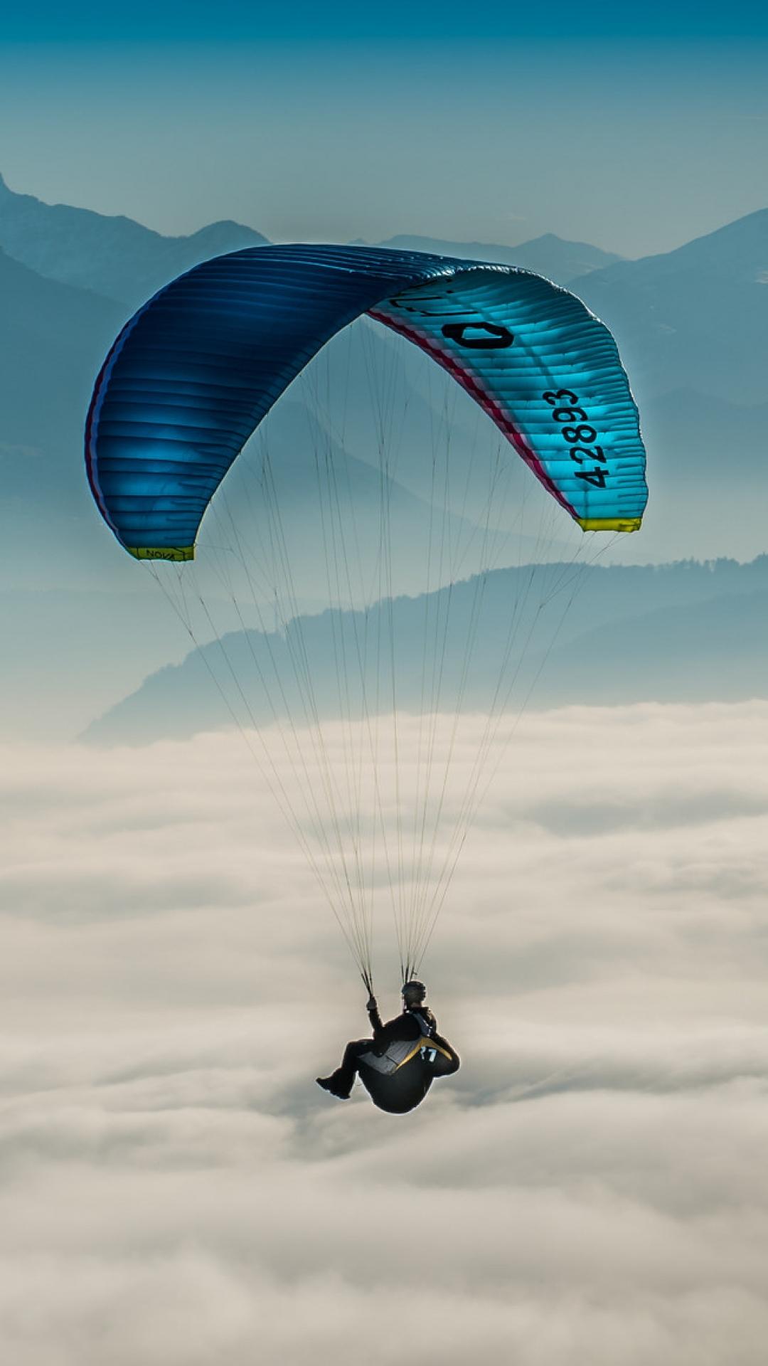 paragliding sky clouds 108156 1080x1920 Paragliding