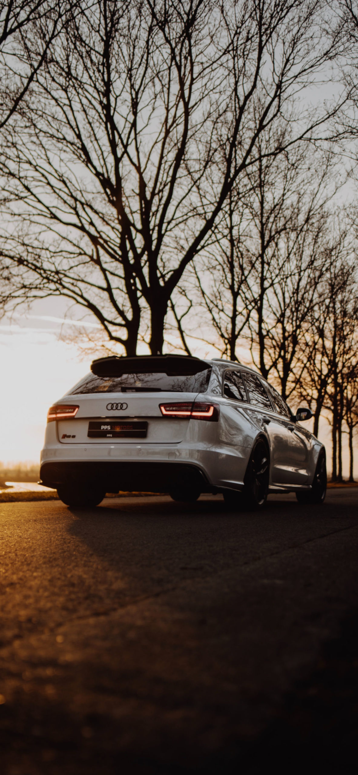 iPhone wallpapers car trees sunset scaled Car