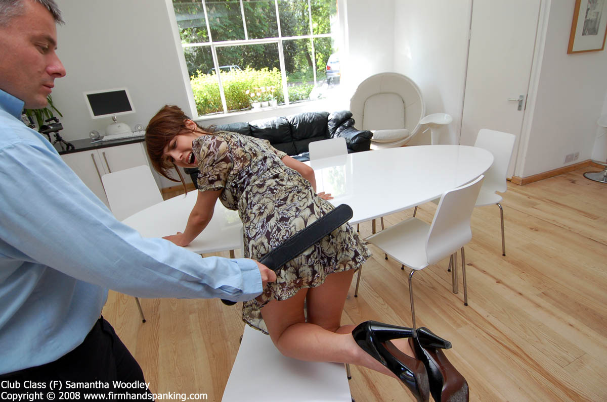 Samantha Woodley bent over for a strapping