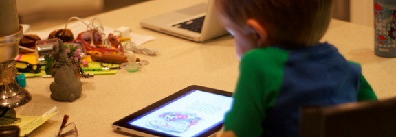 child using ipad as content consumption device
