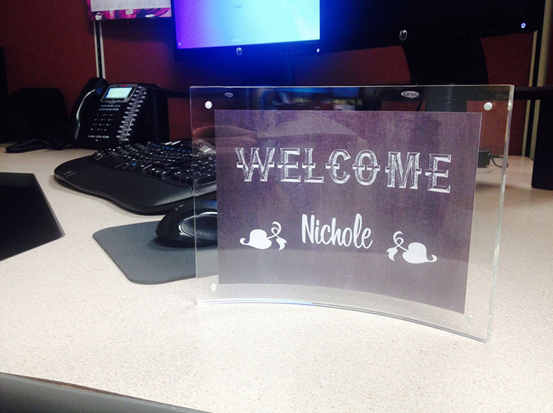 The Clear Curved Acrylic Counter Sign holds high definition poster material in place with magnets on each corner.