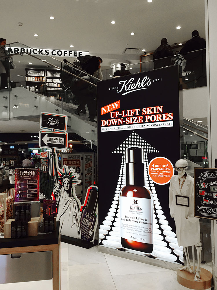 Kiehl's backlit fabric signage display in Macy's