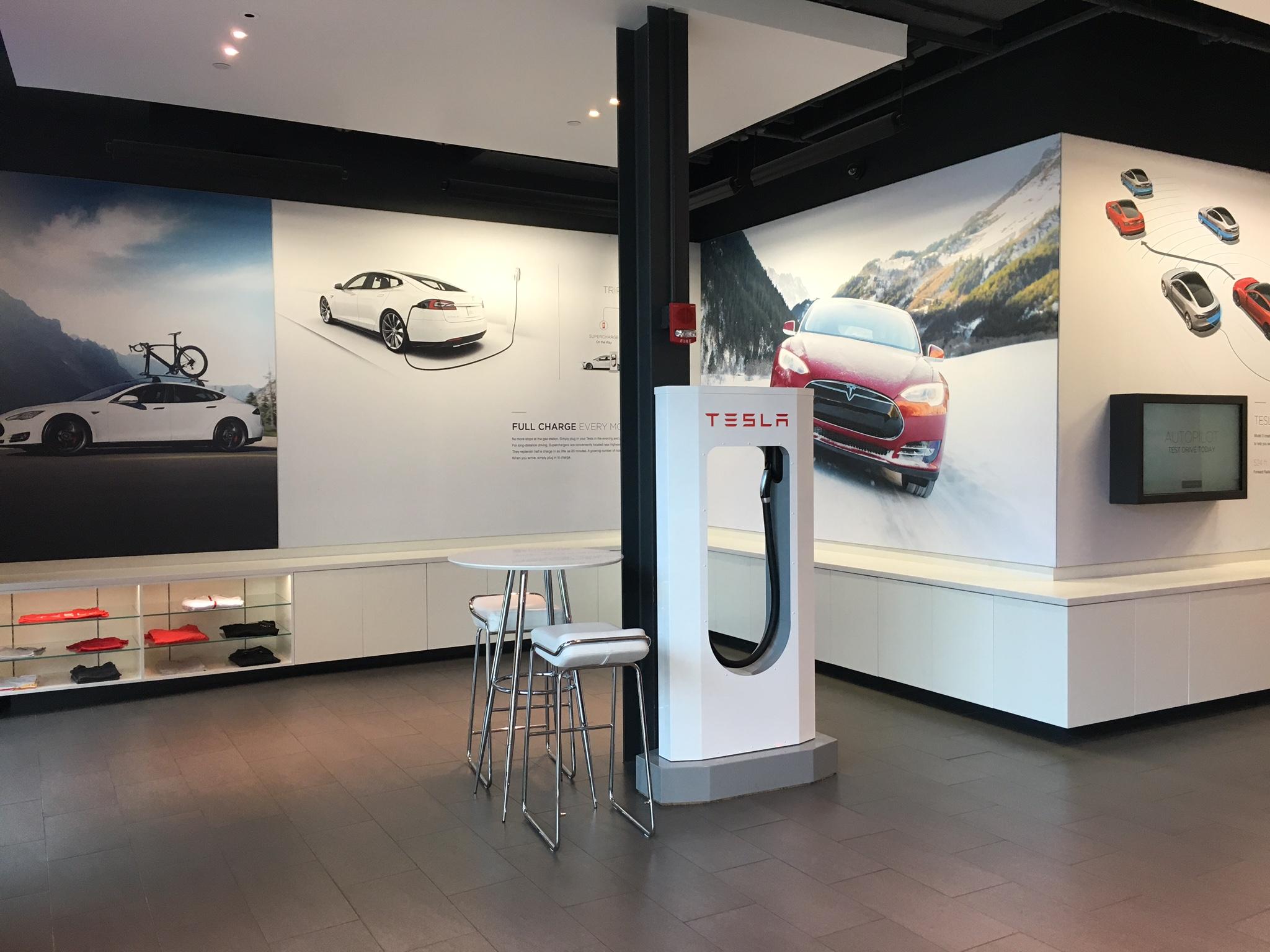 SEG Tension Fabric Signage SEG silicone edge graphics printing signage Tesla car dealership