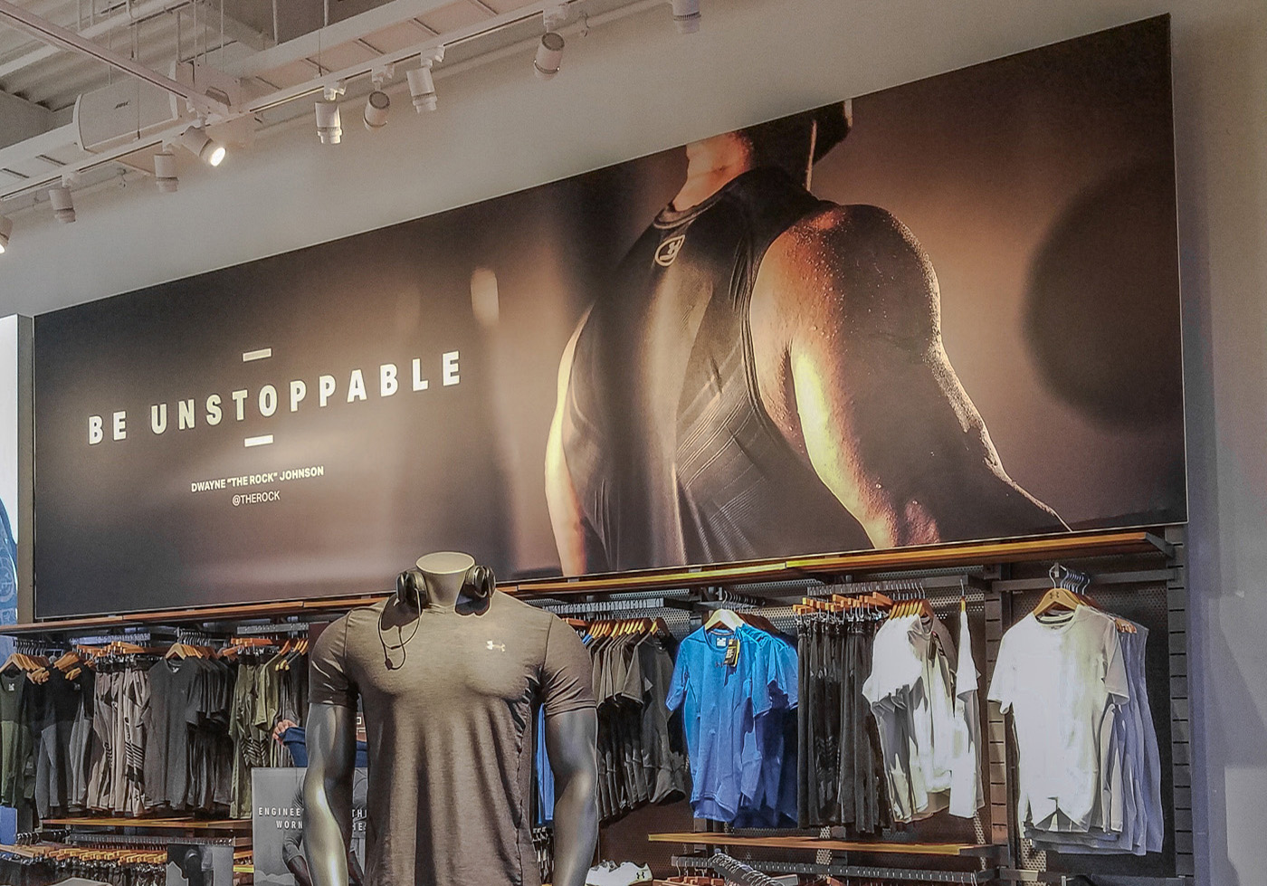 signage SEG fabric tension stretch frame framing sign UnderArmour store retail visuals graphics printing printed marketing merchandising