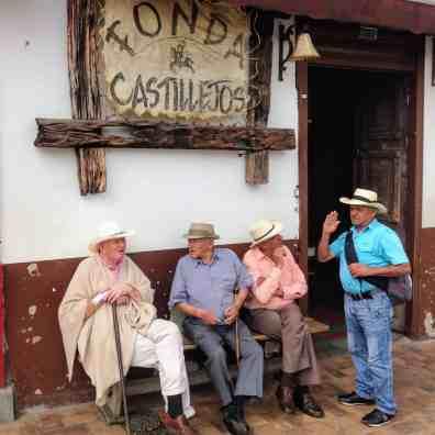 men on the sidewalk San Pedro must see Colombia