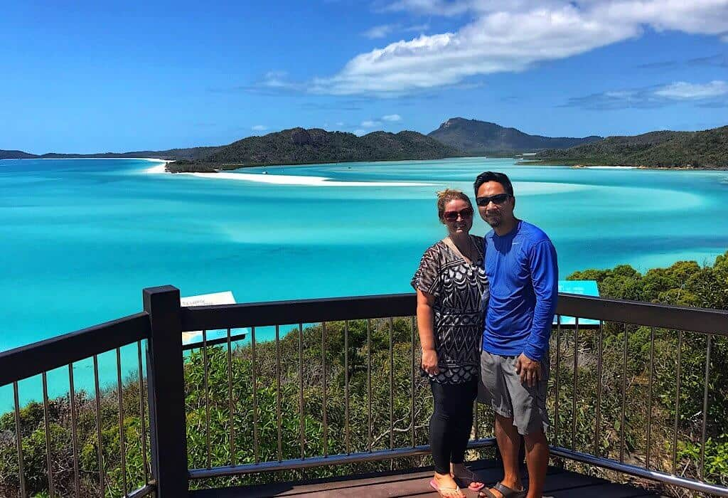 Trinity & Bonnie standing in front of Whitehaven beach in the Whitsundays