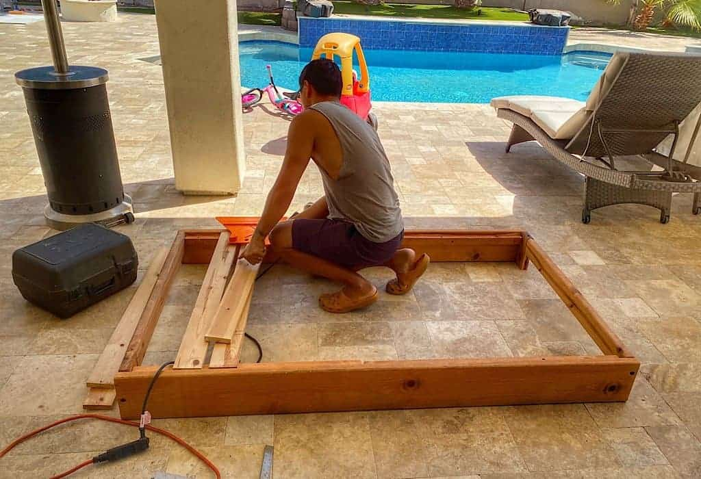 Trin building out the bed frame for our van life