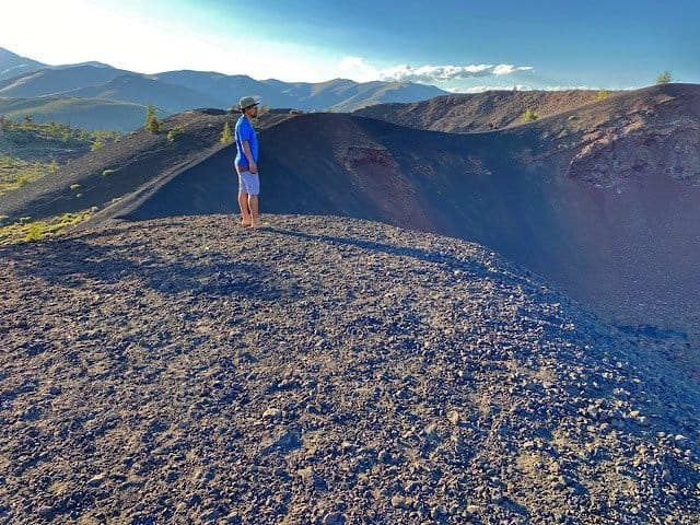 Trin standing on the edge of a crater in Craters of the Moon National Park