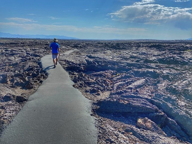 Trin on the path through the black lava field of Craters of the Moon NP, Idaho