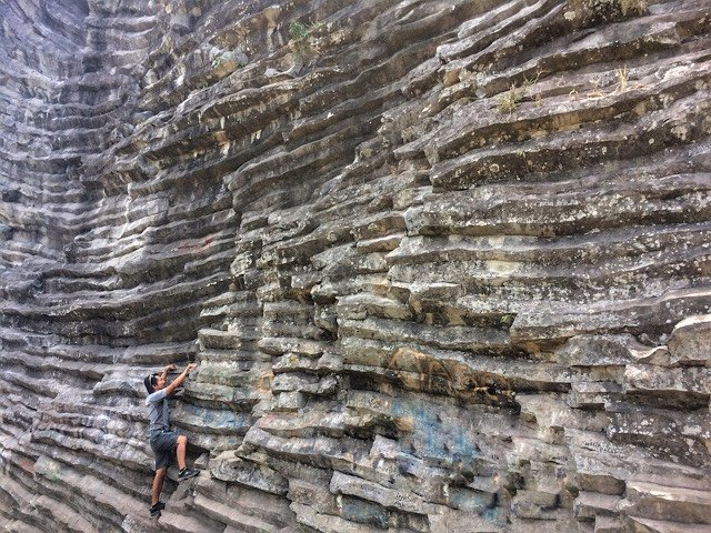 Trin climbing a cliff in Panama