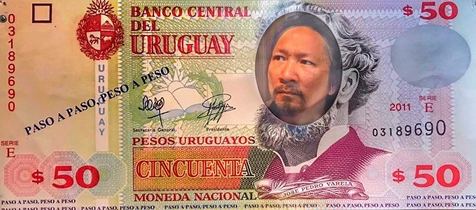 Trin posing for the face of a $50 bill in Uruguay