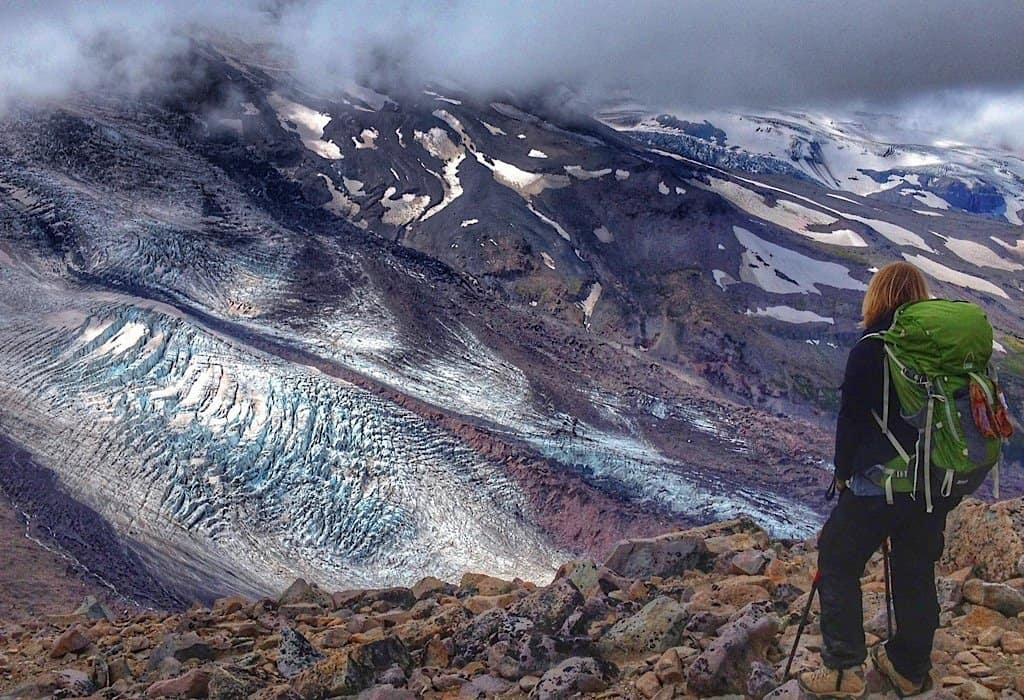 Bonnie standing above a glacier in Washington State