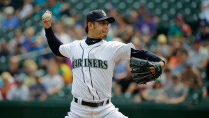 Seattle Mariners starting pitcher Hisashi Iwakuma throws against the Baltimore Orioles in the first inning of a baseball game, Wednesday, Aug. 12, 2015, in Seattle. (AP Photo/Ted S. Warren)