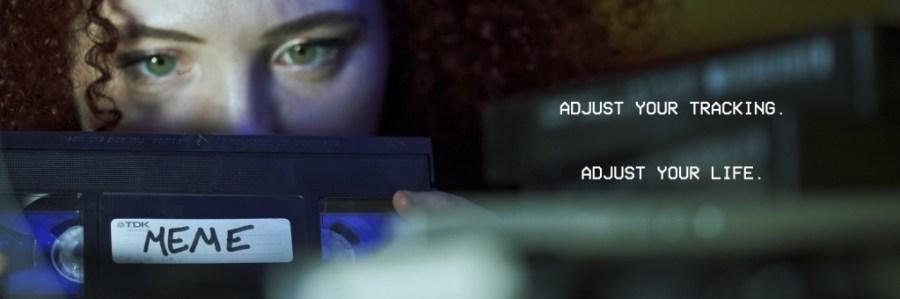 "Actress Sarah Schoofs as Jennifer examining the ""Meme"" videotape"