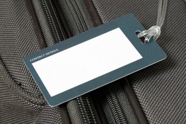 Koffer mit Namensschild