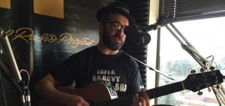 Sam Densmore in a bus t-shirt on Portland Radio Project