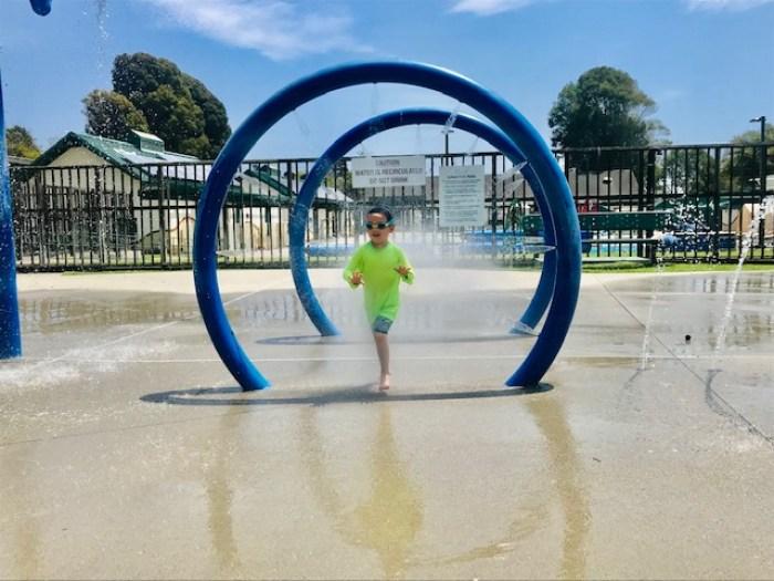 kid running through water