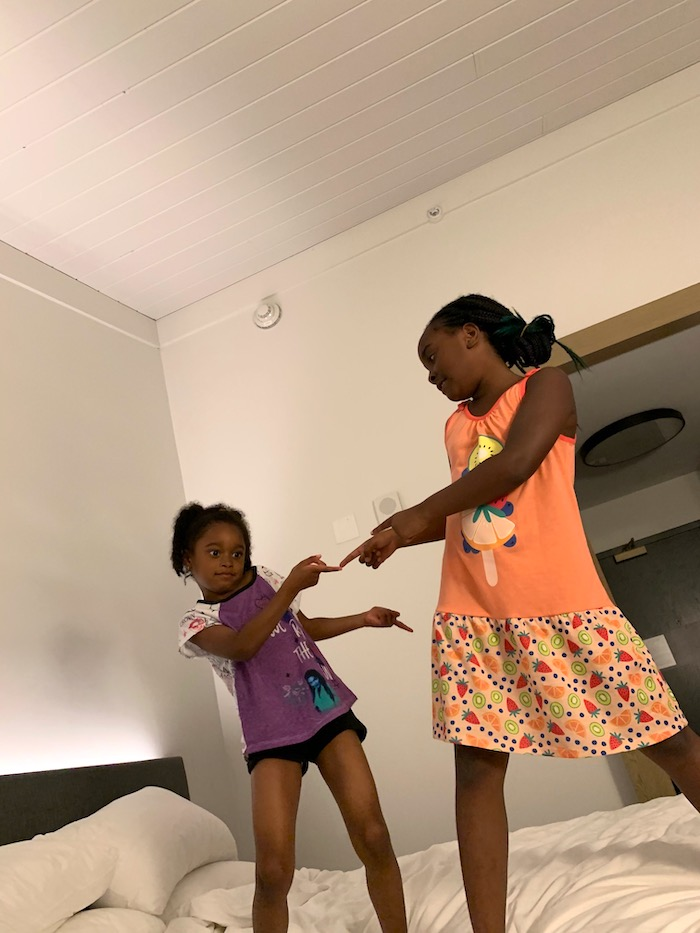 Kids jumping on the hotel bed