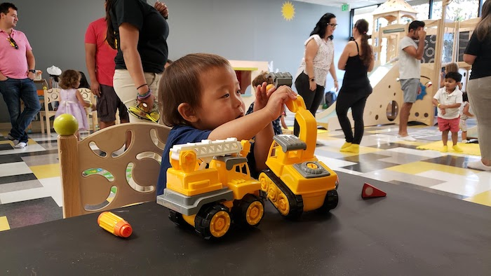Child plays with toy trucks
