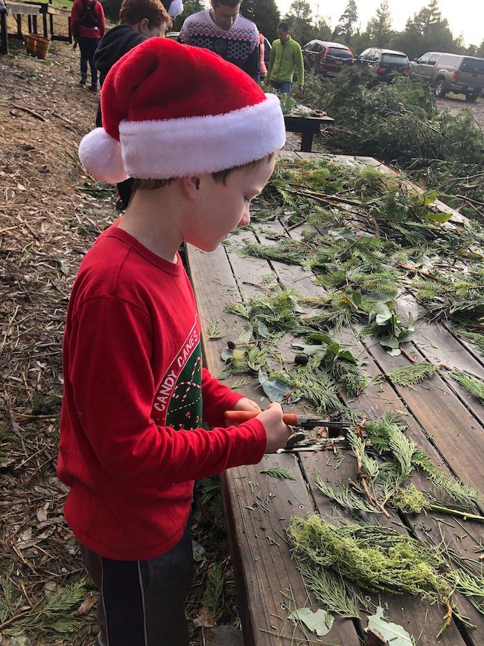 Rancho Siempre Verde kid pretending to making wreath