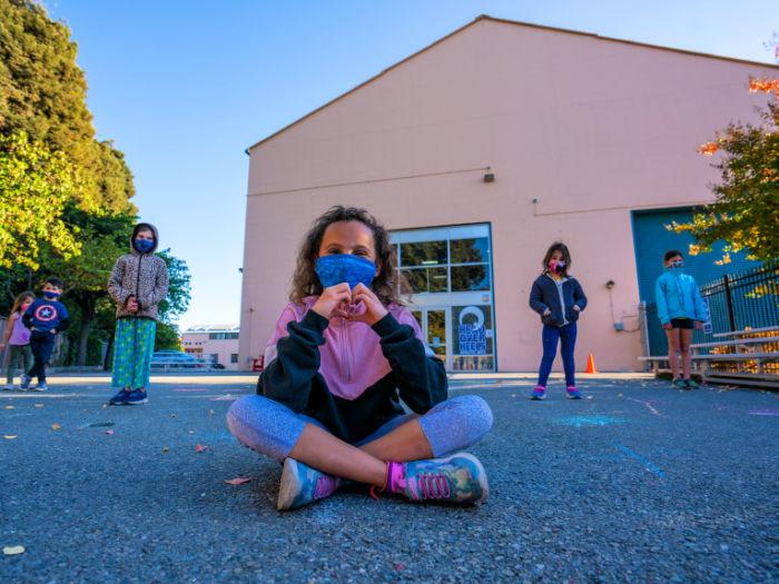 Head over heels students mask outdoors