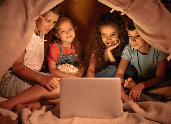 4 kids on a screen probably watching YouTube